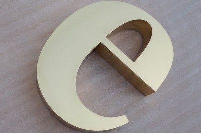 Polished brass signs