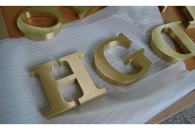 Brushed brass signs