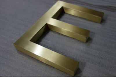 Fabricated brass letters